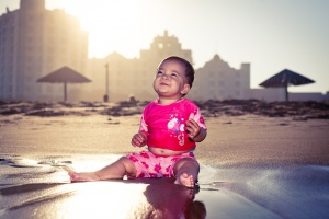 A baby enjoying the beach as only babies can, at Durban by Rafiq Sarlie on Flickr